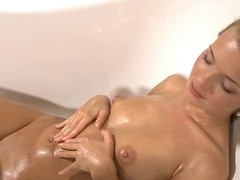 Raunchy nymph is showing delights in advance of masturbating so well